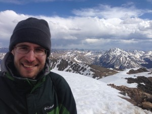 Higher Math Help Owner Greg Stanton Standing Atop Mount Elbert